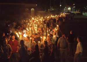 White nationalists carry torches on the grounds of the University of Virginia, on the eve of a planned Unite The Right rally in Charlottesville, Virginia. Alejandro Alvarez/News2Share via REUTERS