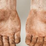 Muddy workmans hands